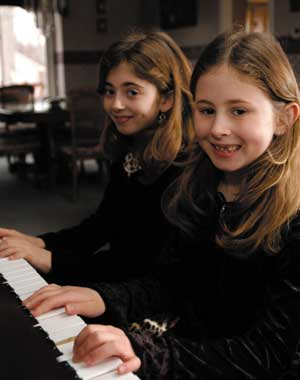 Melanoma survivor, Hannah Fischer makes music with her older sister, Justine