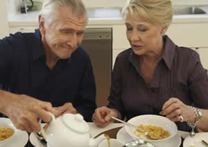image of a man and woman having breakfast