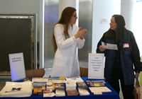 image of a Cancer AnswerLine nurse talking with a guest