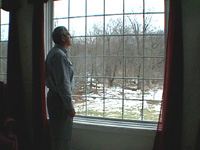 image of man by window