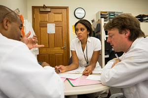 Members of the Genetics Clinic Team review test results
