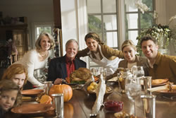 Image of a family around a dinner table