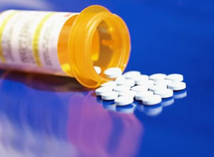 Image of prescription bottle and pills