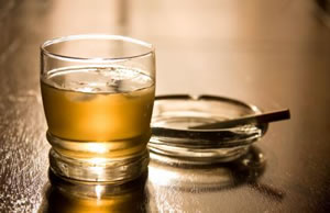 Photo of cigarette and glass of liquor