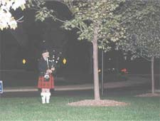 "At the end of the candle lighting ceremony, a bagpiper played a moving rendition of ""Amazing Grace."""