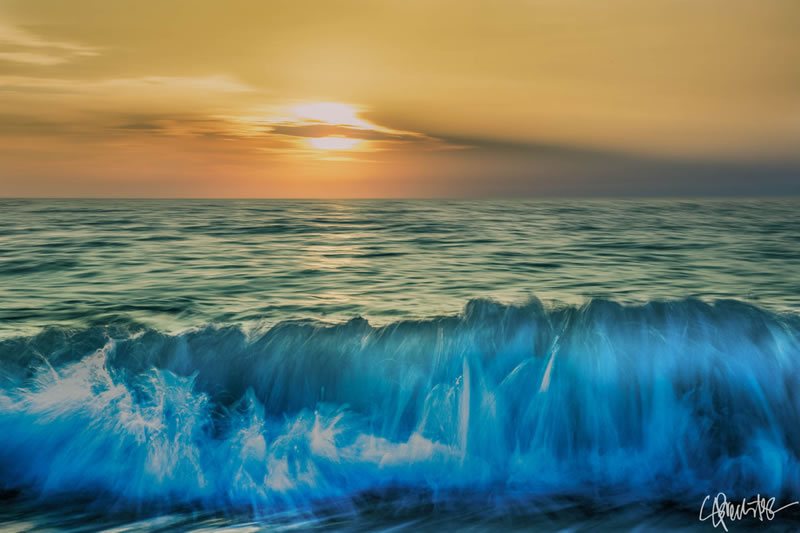 image of waves rolling to the shore at sunset