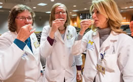 image of the three dieticians sampling liquid supplements
