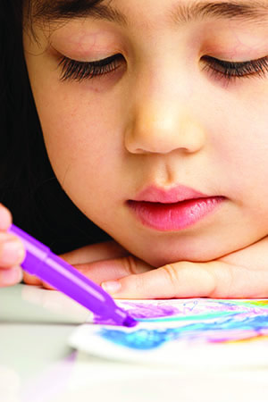 image of little girl coloring