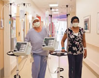 Patients walking down the cancer center hallway together